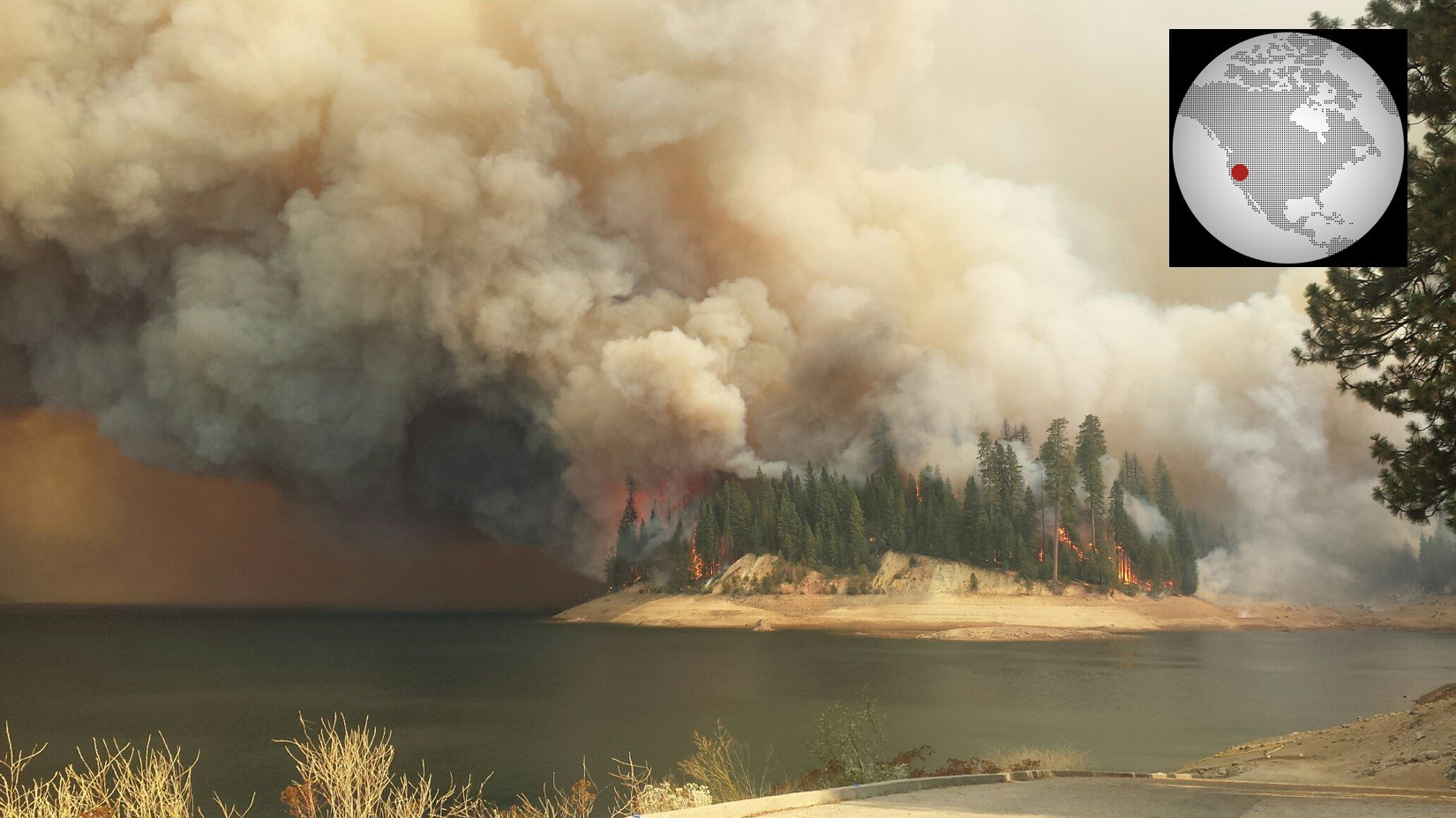 This image captures the King Fire actively burning through Stumpy Meadows Campground located on Stumpy Meadows Reservoir, CA (Photo by U.S. Forest Service Region 5).