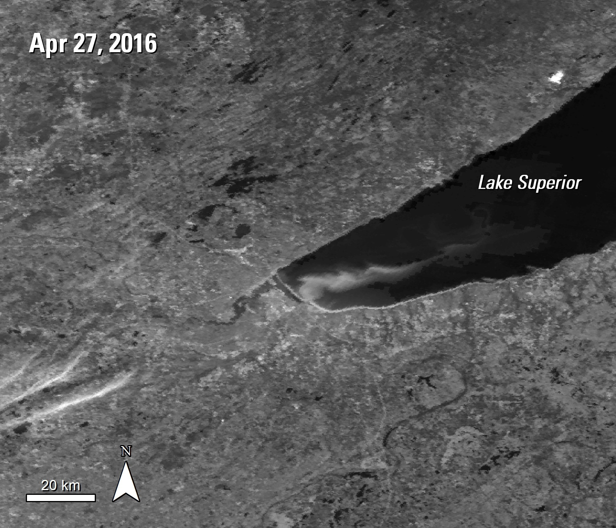 A black and white MODIS Surface Reflectance image over Lake Superior, Minnesota and Wisconsin, United States. A plume is visible over the bottom left portion of this section of the lake, acquired April 27, 2016.