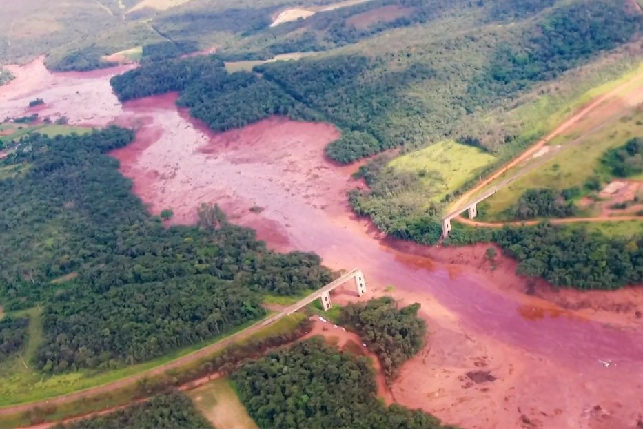 Public domain image of the aftermath of the Brumadinho dam collapse, with flooded areas and a bridge washed out.